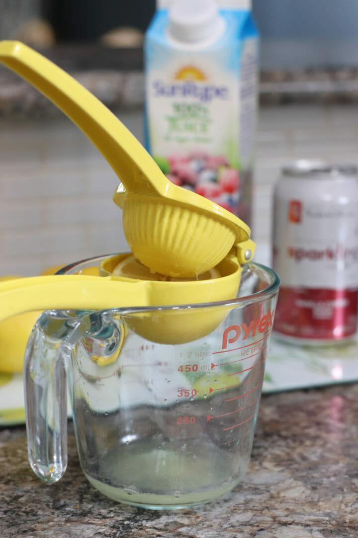 Squeezing fresh lemons